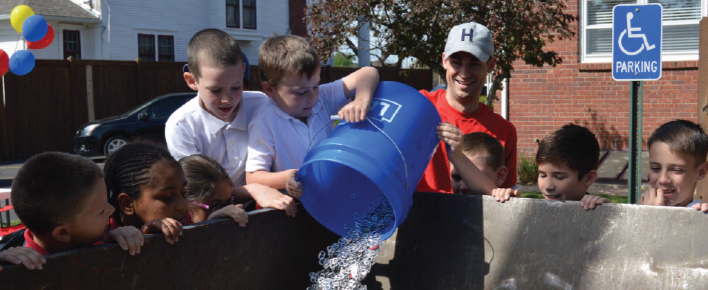 Students pour pull tabs on Pull Tab Collection Day 2016